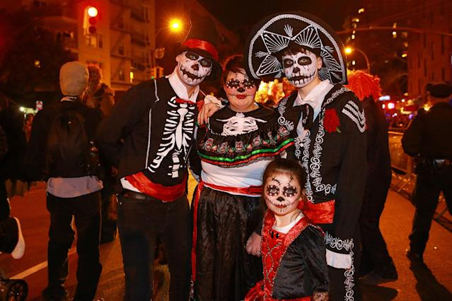 <p>People in Day of the Dead costumes pose for a photo during the 44th annual Village Halloween Parade in New York City on Oct. 31, 2017. (Photo: Gordon Donovan/Yahoo News) </p>