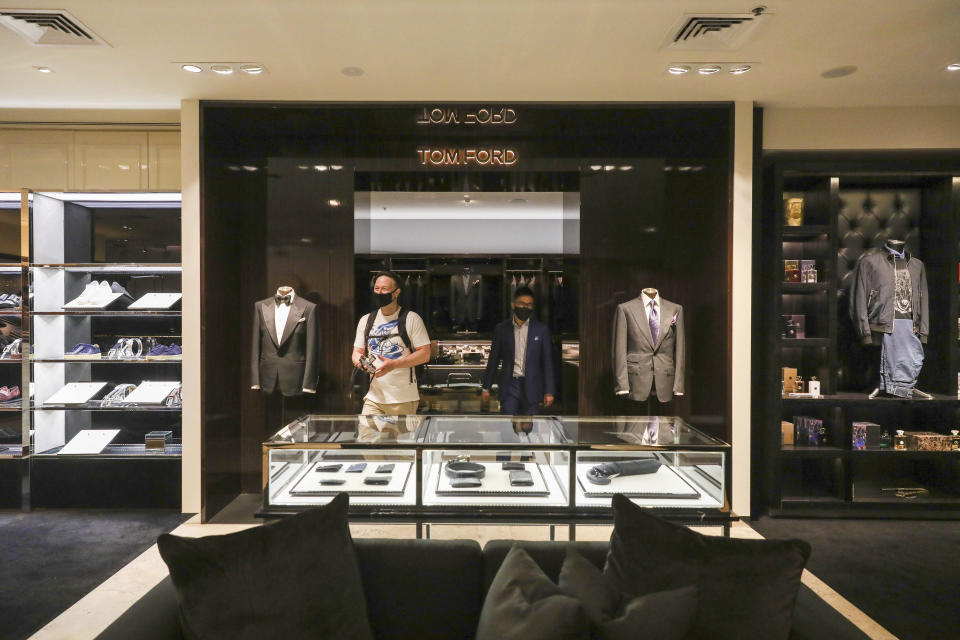 A customer visits high end luxury boutique department store Harrolds in Melbourne, Australia, Wednesday, Oct. 28, 2020. (AP Photo/Asanka Brendon Ratnayake)