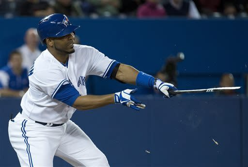 Toronto Blue Jays' Edwin Encarnacion breaks his bat while playing against the Baltimore Orioles during fourth-inning AL baseball game action in Toronto, Friday May 24, 2013. (AP Photo/The Canadian Press, Nathan Denette)