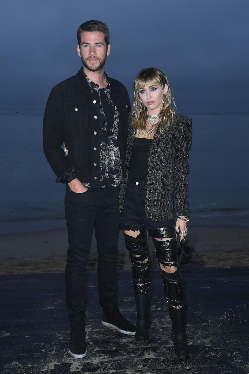 On June 6, newlyweds Miley Cyrus and Liam Hemsworth joined a gaggle of stars for the Saint Laurent SS20 show in Miami. <em>[Photo: Getty]</em>