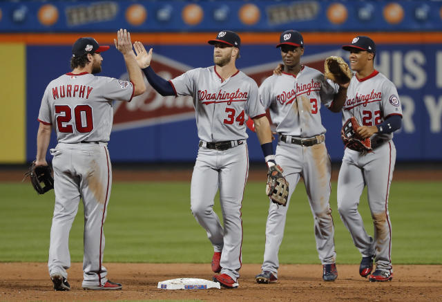 The Washington Nationals celebrate after defeating the New York Mets 5-4 in a baseball game Thursday, July 12, 2018, in New York. (AP Photo/Julie Jacobson)
