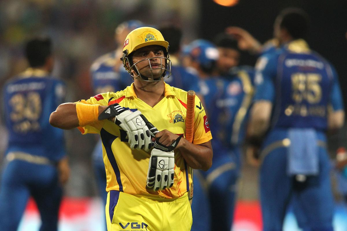 Suresh Raina of the Chennai Super Kings walks back to the dug out after losing his wicket as Mumbai Indians celebrate during the Final of the Pepsi Indian Premier League between The Chennai Superkings and the Mumbai Indians held at the Eden Gardens Stadium in Kolkata on the 26th May 2013..Photo by Saikat Das-IPL-SPORTZPICS       ..Use of this image is subject to the terms and conditions as outlined by the BCCI. These terms can be found by following this link:..https://ec.yimg.com/ec?url=http%3a%2f%2fwww.sportzpics.co.za%2fimage%2fI0000SoRagM2cIEc&t=1490568317&sig=cd6y17IR26vuFRfEmC4ZeQ--~C