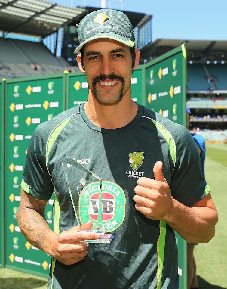 MELBOURNE, AUSTRALIA - DECEMBER 29:  Mitchell Johnson of Australia poses with the man of the match award after day four of the Fourth Ashes Test Match between Australia and England at Melbourne Cricket Ground on December 29, 2013 in Melbourne, Australia.  (Photo by Scott Barbour/Getty Images)