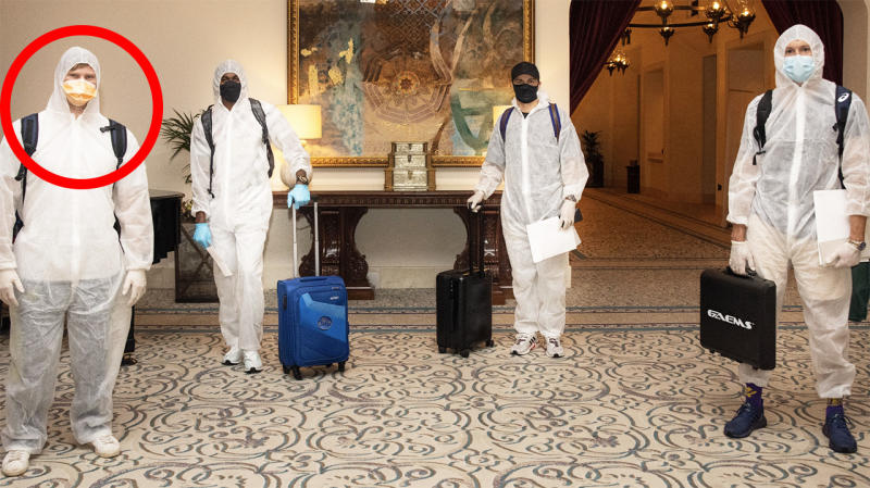 Steve Smith, pictured left, is seen in a hazmat suit after arriving to play for the Rajasthan Royals.