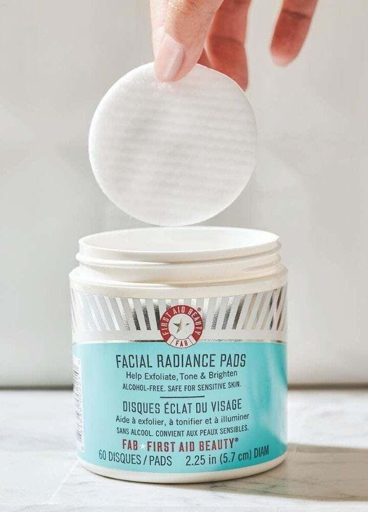 """Get a glowing complexion in as much time as it takes you to pick up a pad, gently swipe it across your face and toss it in the trash. They're alcohol-free and safe to use on sensitive skin.<br /><br /><strong>Promising review:</strong>""""I started using this product months ago when I started noticing clogged pores and tiny bumps on my cheeks. This product has been a life-saver! <strong>Not only did this help eliminate my clogged pores, but it leaves my face glowing!</strong> I have very sensitive skin and haven't had any issues with it."""" —<a href=""""https://www.amazon.com/gp/customer-reviews/R14HC8F4BI2X35"""" target=""""_blank"""" rel=""""nofollow noopener noreferrer"""" data-skimlinks-tracking=""""5582326"""" data-vars-affiliate=""""Amazon"""" data-vars-href=""""https://www.amazon.com/gp/customer-reviews/R14HC8F4BI2X35?tag=bfjasmin-20&ascsubtag=5582326%2C7%2C25%2Cmobile_web%2C0%2C0%2C0"""" data-vars-keywords=""""cleaning"""" data-vars-link-id=""""0"""" data-vars-price="""""""" data-vars-retailers=""""Amazon"""">Melissa House<br /><br /></a><strong>Get a pack of 28 from Amazon for<a href=""""https://amzn.to/2R0iG7x"""" target=""""_blank"""" rel=""""nofollow noopener noreferrer"""" data-skimlinks-tracking=""""5582326"""" data-vars-affiliate=""""Amazon"""" data-vars-asin=""""B00E985KG8"""" data-vars-href=""""https://www.amazon.com/dp/B00E985KG8?tag=bfjasmin-20&ascsubtag=5582326%2C7%2C25%2Cmobile_web%2C0%2C0%2C1148886"""" data-vars-keywords=""""cleaning"""" data-vars-link-id=""""1148886"""" data-vars-price="""""""" data-vars-product-id=""""15928869"""" data-vars-product-img=""""https://m.media-amazon.com/images/I/4178OabvuEL._SL500_.jpg"""" data-vars-product-title=""""First Aid Beauty Facial Radiance Pads, Exfoliating Pads with AHA, 28 Count"""" data-vars-retailers=""""Amazon"""">$18+</a>(available in two sizes).</strong>"""