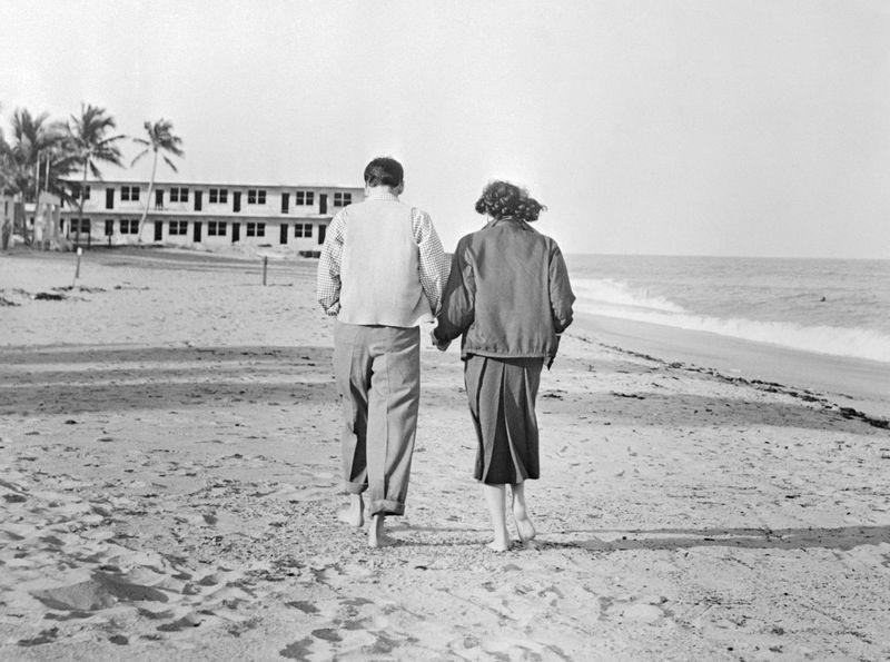 <p>The couple walks along the beach in Miami in 1951, but this was more than a typical vacation—Sinatra and Gardner tied the knot in Philadelphia two days before arriving in Florida.</p>