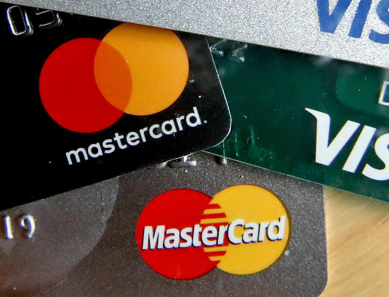 FILE - In this Feb. 20, 2019, file photo are Mastercard and Visa credit cards in Zelienople, Pa. Americans gave their credit cards a real workout this past holiday season. The Federal Reserve said Friday, Feb. 7, 2020, that borrowing on credit cards rose by the largest amount in more than two decades in December. (AP Photo/Keith Srakocic, File)
