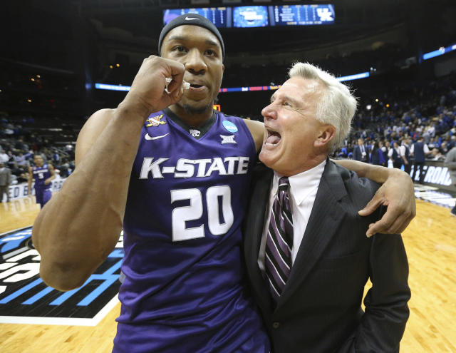 Kansas State coach Bruce Weber and forward Xavier Sneed celebrate the team's 61-58 win over Kentucky during an NCAA men's college basketball tournament regional semifinal early Friday, March 23, 2018, in Atlanta. (Curtis Compton/Atlanta Journal-Constitution via AP)
