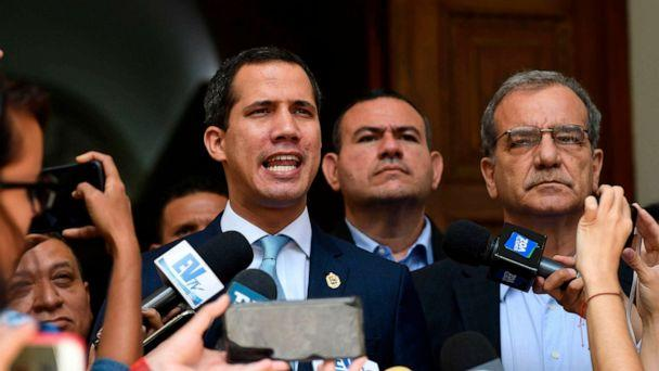 PHOTO: Venezuelan opposition leader and self-proclaimed acting president Juan Guaido (L) speaks to the press before a session at the National Assembly in Caracas on August 6, 2019. (Federico Parra/AFP/Getty Images)