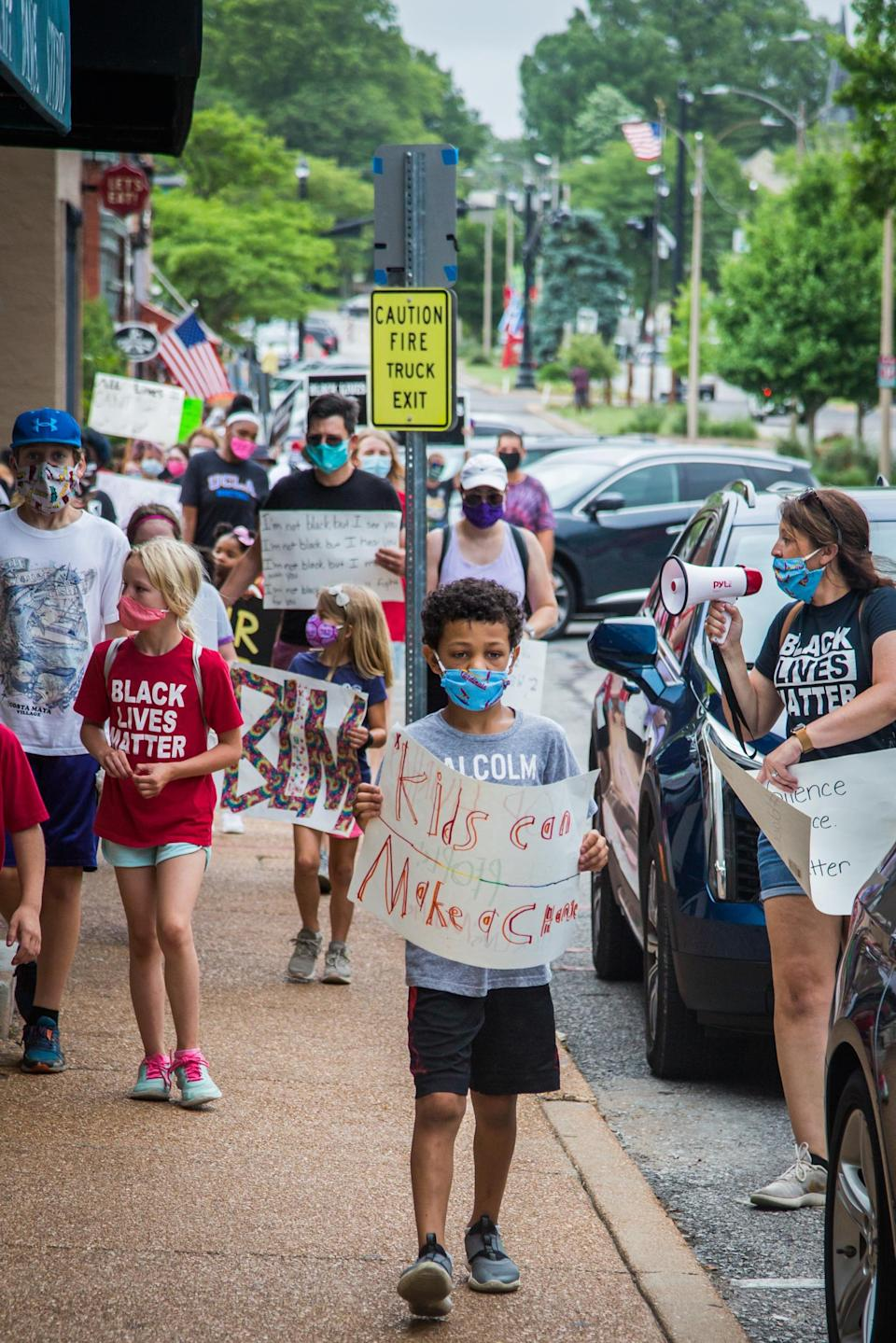 Nolan, seen with fellow participants walked the streets of Kirkwood, Missouri with Black Lives Matter signs. (Photo: Bailey Elizabeth Rogers)
