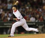 Boston Red Sox pitcher Junichi Tazawa delivers during the fourth inning of a baseball game against the Los Angeles Angels at Fenway Park in Boston, Thursday, Aug. 23, 2012. (AP Photo/Charles Krupa)