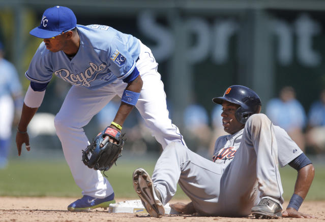 Detroit Tigers' Austin Jackson, right, watches the ball get past Kansas City Royals shortstop Alcides Escobar (2) during the fifth inning of a baseball game at Kauffman Stadium in Kansas City, Mo., Sunday, May 4, 2014. Jackson stole second base on the play. (AP Photo/Orlin Wagner)