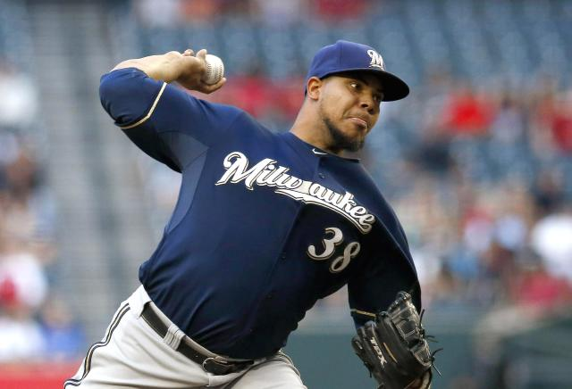 Milwaukee Brewers' Wily Peralta throws a pitch against the Arizona Diamondbacks during the first inning of a baseball game on Monday, June 16, 2014, in Phoenix. (AP Photo/Ross D. Franklin)
