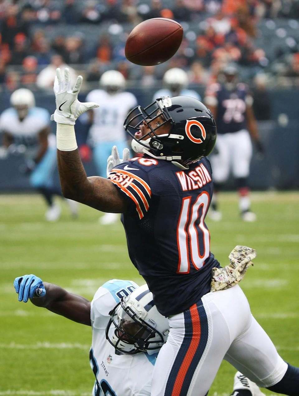 <p>Chicago Bears wide receiver Marquess Wilson (10) reaches for the ball as Tennessee Titans cornerback Jason McCourty (30) defends on Sunday, Nov. 27, 2016 at Soldier Field in Chicago, Ill. McCourty was called for defensive pass interference on the play. (John J. Kim/Chicago Tribune/TNS via Getty Images) </p>