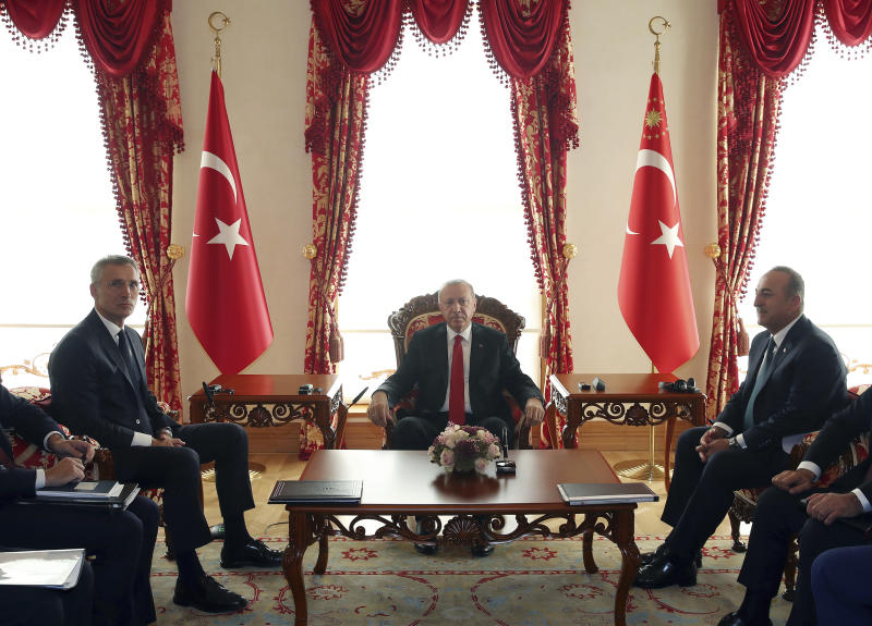 NATO Secretary General Jens Stoltenberg, left, with Turkey's President Recep Tayyip Erdogan, center, and Foreign Minister Mevlut Cavusoglu during a meeting, in Istanbul, Friday, Oct. 11, 2019. NATO's secretary-general says Friday he acknowledges Turkey's legitimate security concerns but has urged Ankara to exercise restraint in its incursion into northeast Syria.(Presidential Press Service via AP, Pool)