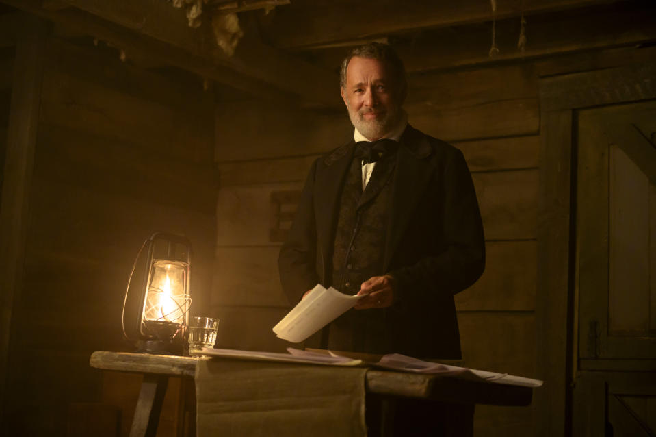 """This image released by Universal Pictures shows Tom Hanks in a scene from """"News of the World."""" (Bruce W. Talamon/Universal Pictures via AP)"""