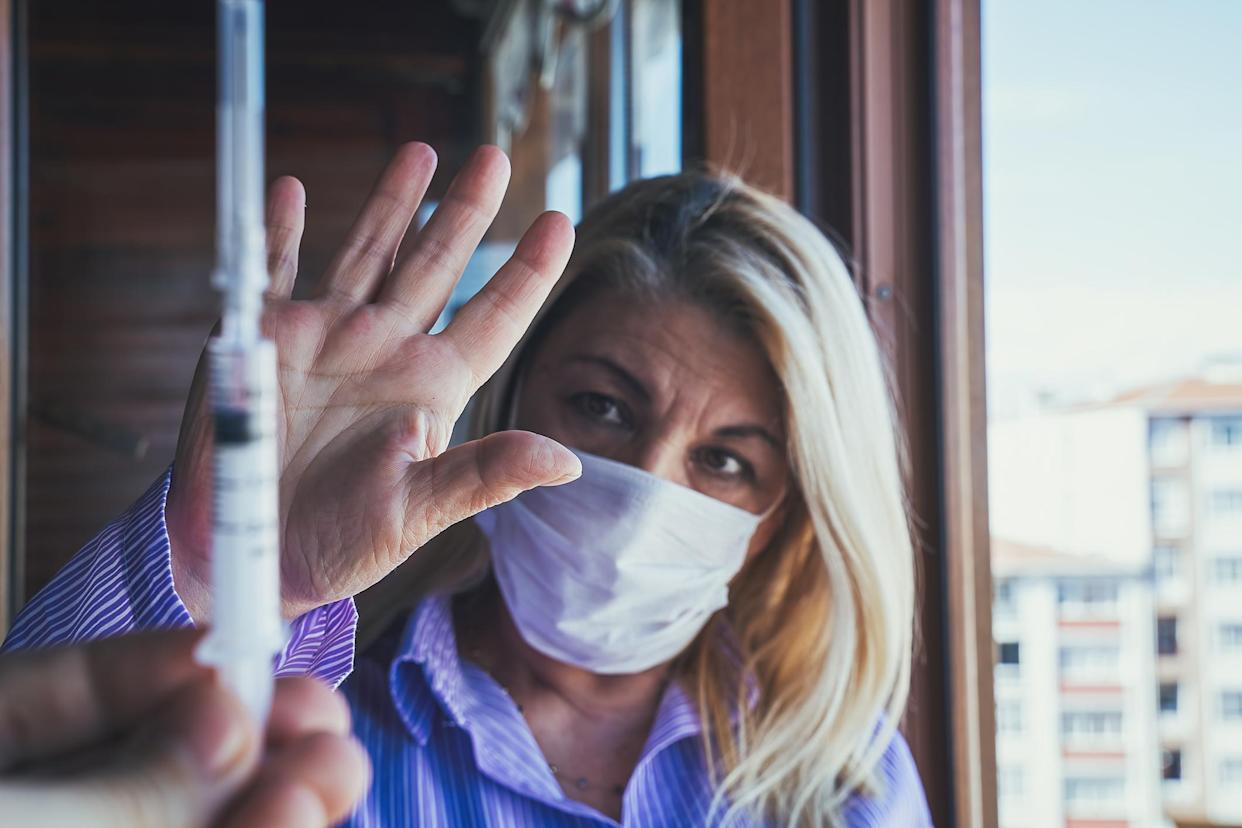 Getting the COVID vaccine isn't mandatory. (Getty Images)