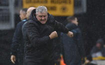 Newcastle's head coach Steve Bruce reacts after Newcastle's Jeff Hendrick scored his side's opening goal during the English Premier League soccer match between Wolverhampton Wanderers and Newcastle United at Molineux stadium in Wolverhampton, England, Saturday, Oct. 2, 2021. (AP Photo/Rui Vieira)