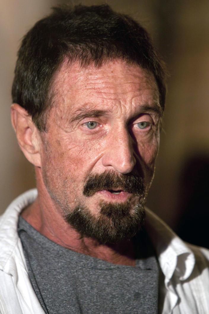 """Software company founder John McAfee speaks during an interview at a local restaurant in Guatemala City, Tuesday, Dec. 4, 2012. McAfee, 67, has been identified as a """"person of interest"""" in the killing of his neighbor in Belize, 52-year-old Gregory Faull. Police are urging McAfee to come in for questioning. The anti-virus company founder fled Belize and is seeking political asylum in Guatemala, according to his lawyer Telesforo Guerra. (AP Photo/Moises Castillo)"""