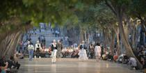 <p>Then came the actual Chanel cruises show, staged down a promenade with live musicians. Models sauntered up and down in white ruffled skirts, boater hats, Riviera style wide-leg trousers and everything else you would need for the chicest holiday wardrobe. </p>