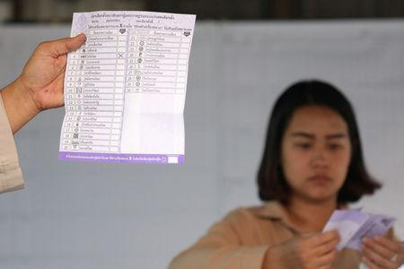 Electoral staff members show a ballot during vote counting at the general election in Mae Hong Son, Thailand, March 24, 2019. REUTERS/Ann Wang