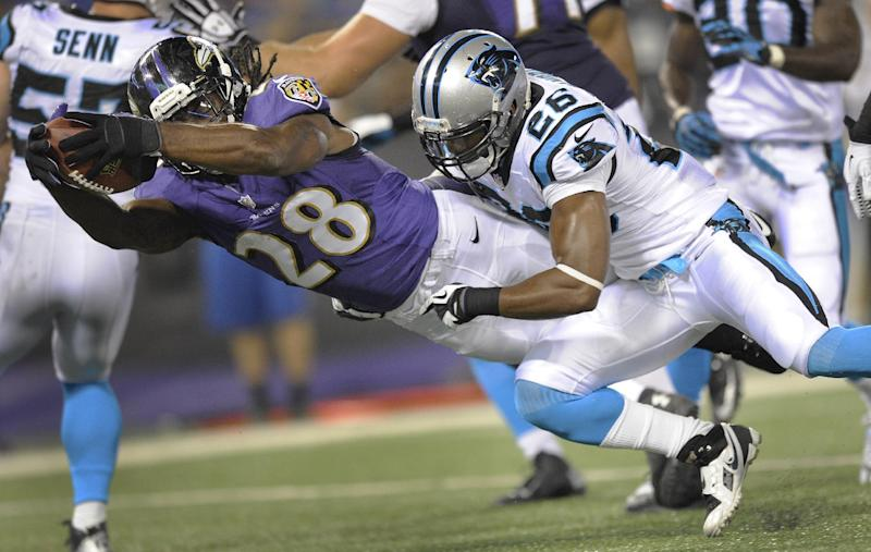 Baltimore Ravens running back Damien Berry drives into the end zone for a touchdown as Carolina Panthers strong safety D.J. Campbell hangs on during the second half of a preseason NFL football game in Baltimore, Thursday, Aug. 22, 2013. (AP Photo/Nick Wass)