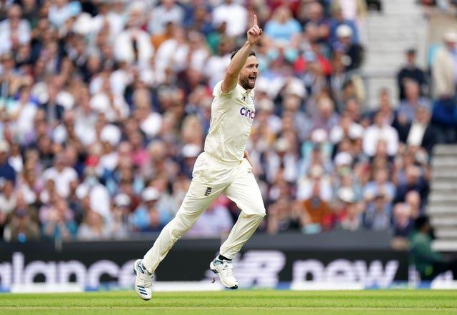 Chris Woakes celebrates his first wicket