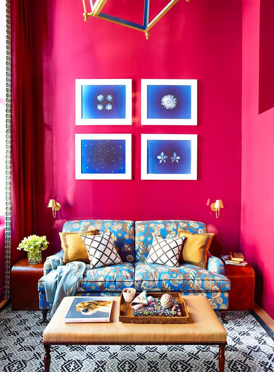 """<p>Intense, eye-catching, and adventurous, the neon pink walls in this Greenwich Village living room designed by <a href=""""https://www.katieridder.com/"""" rel=""""nofollow noopener"""" target=""""_blank"""" data-ylk=""""slk:Katie Ridder"""" class=""""link rapid-noclick-resp"""">Katie Ridder</a> (she used <a href=""""https://c2paint.com/products/mulberry-c2-507"""" rel=""""nofollow noopener"""" target=""""_blank"""" data-ylk=""""slk:C2 Paints' Mulberry"""" class=""""link rapid-noclick-resp"""">C2 Paints' Mulberry</a>) are a bold choice that paid off. Contrasting sky blue tones and traditional furniture make it more transitional and timeless than quirky. Use the shade in a foyer for a warm, welcoming, impossible-to-forget entrance.</p>"""
