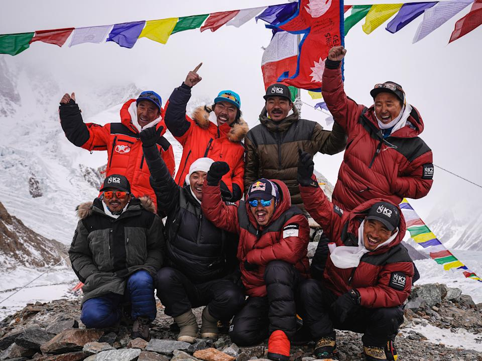 <p>Nirmal 'Nims' Purja (centre, second from right), one of the climbers, is pictured on 5 January during the Puja ceremony before successfully attempting to climb K2</p> (Nimsdai/Red Bull Content Poolim)