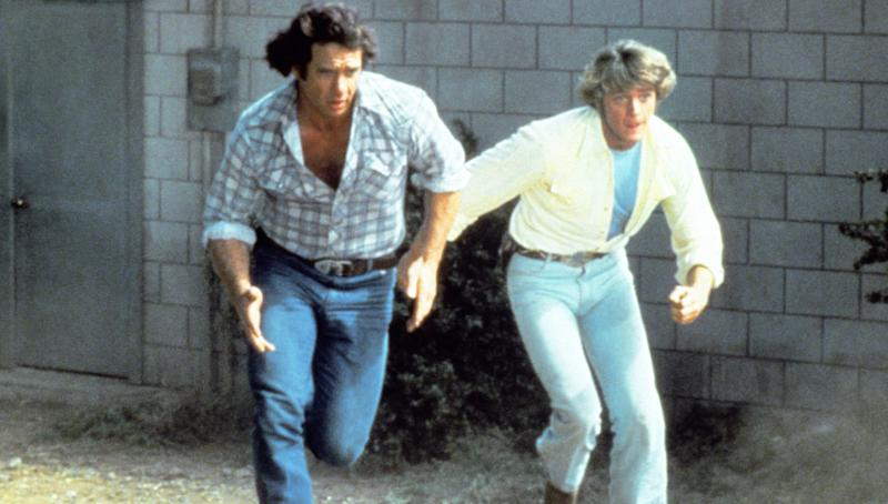 Wopat and Schneider run for cover in an episode of 'The Dukes of Hazzard' (Photo: Courtesy Everett Collection)