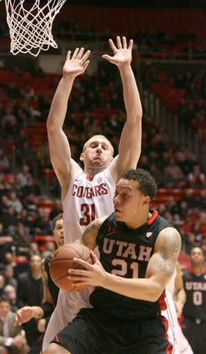 Utah's Javon Dawson (21) tries to get around Washington State's Abe Lodwick (31) during an NCAA college basketball game between Utah and Washington State, Thursday, Jan. 5, 2012, in Salt Lake City. (AP Photo/The Deseret News, Paul Fraughton) SALT LAKE TRIBUNE OUT; PROVO DAILY HERALD OUT; MAGS OUT