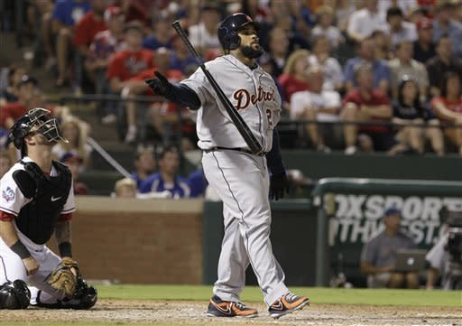 Detroit Tigers' Prince Fielder (28) and Texas Rangers catcher Mike Napoli watch Fielder's home run sail away during the sixth inning of a baseball game on Friday, Aug. 10, 2012, in Arlington, Texas. (AP Photo/LM Otero)