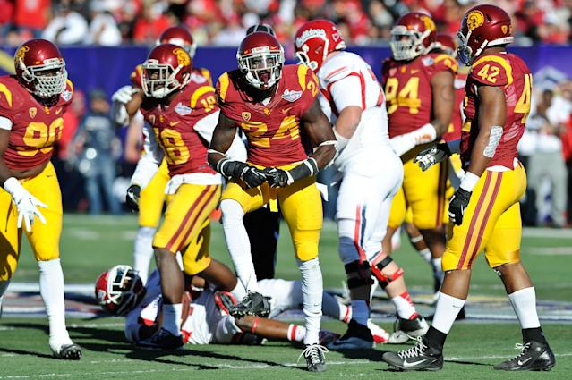 Southern California safety Demetrius Wright (24) celebrates after making a tackle against Fresno State during the first quarter of the Royal Purple Bowl NCAA college football game, Saturday, Dec. 21, 2013, in Las Vegas. (AP Photo/David Cleveland)