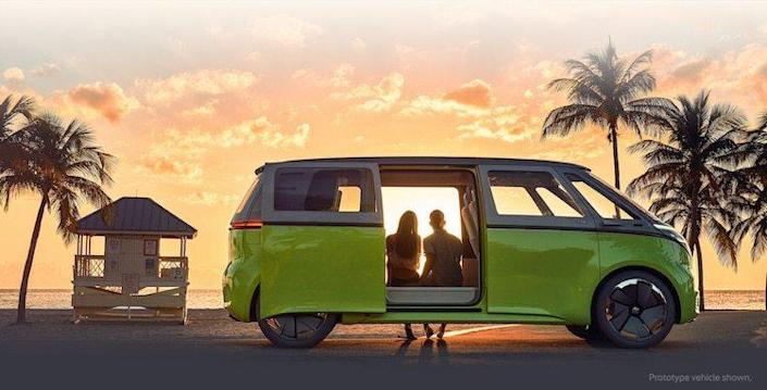 Couple watches the sunset from the comfort of their fully electric Volkswagen I.D. Buzz.
