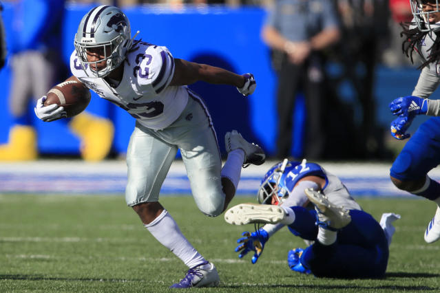 Kansas State wide receiver Joshua Youngblood (23) breaks away from Kansas safety Jeremiah McCullough (12) during the first half of an NCAA college football game in Lawrence, Kan., Saturday, Nov. 2, 2019. (AP Photo/Orlin Wagner)