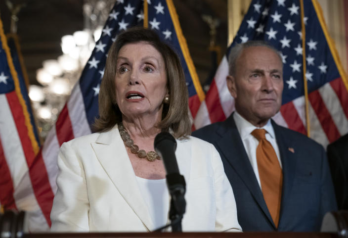 Speaker of the House Nancy Pelosi, D-Calif., joined at right by Senate Minority Leader Chuck Schumer, D-N.Y., calls for a Senate vote on the House-passed Bipartisan Background Checks Act as Congress returns for the fall session with pressure mounting on Senate Majority Leader Mitch McConnell to address gun violence, at the Capitol in Washington, Monday, Sept. 9, 2019. (AP Photo/J. Scott Applewhite)