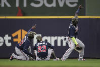 Atlanta Braves' Marcell Ozuna, right, poses with Ehire Adrianza (23) and Guillermo Heredia (38) after the the team's baseball game against the Milwaukee Brewers on Saturday, May 15, 2021, in Milwaukee. (AP Photo/Aaron Gash)