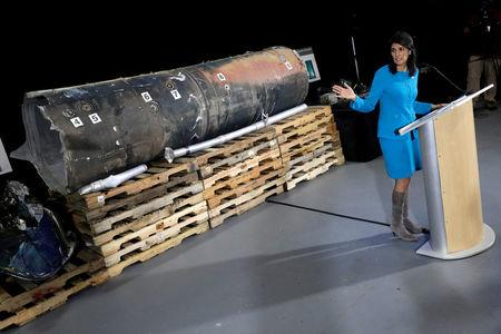 """U.S. Ambassador to the United Nations Nikki Haley briefs the media in front of remains of Iranian """"Qiam"""" ballistic missile"""