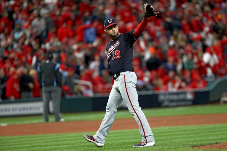 Washington pitcher Anibal Sanchez acknowledges Jose Martinez of the St. Louis Cardinals whose eighth inning single ended Sanchez's no-hit bid in the Nationals' victory over the Cardinals in game one of Major League Baseball's National League Championship Series