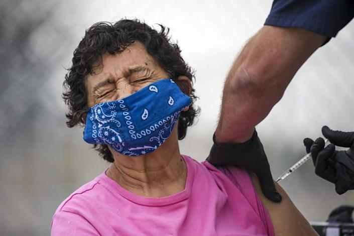 Los Angeles, CA - February 09: Eugenia Solis gets a COVID-19 vaccine at a mobile vaccination site launched by Los Angeles Councilman Curren Price Jr. at South Park Recreation Center on Tuesday, Feb. 9, 2021 in Los Angeles, CA.(Irfan Khan / Los Angeles Times)