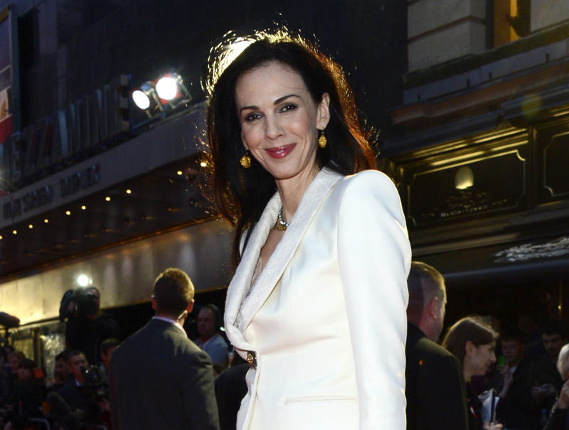 "FILE - This Oct. 18, 2012 file photo shows fashion designer L'Wren Scott at the London Film Festival American Express Gala for ""The Rolling Stones - Crossfire Hurricane"", in London. Scott is to be remembered on Friday, May 2, 2014, at a Manhattan memorial service, expected to be attended by her longtime companion, Mick Jagger, and others close to her. The service for Scott, a noted fashion designer and stylist who committed suicide March 17, will be held at St. Bartholomew's Church. (Photo by Jon Furniss/Invision, File)"