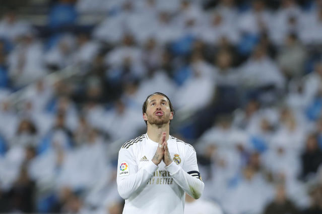 Real Madrid's Sergio Ramos reacts during the Spanish La Liga soccer match between Real Madrid and Barcelona at the Santiago Bernabeu stadium in Madrid, Spain, Sunday, March 1, 2020. (AP Photo/Manu Fernandez)