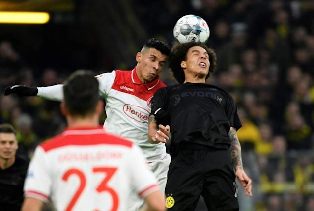Midfielder Axel Witsel (R) helped Borussia Dortmund to a 5-0 win over Fortuna Duesseldorf on Saturday (AFP Photo/INA FASSBENDER)