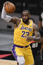 Los Angeles Lakers' LeBron James grabs a rebound during the first half of the team's NBA basketball game against the San Antonio Spurs, Friday, Jan. 1, 2021, in San Antonio. (AP Photo/Darren Abate)