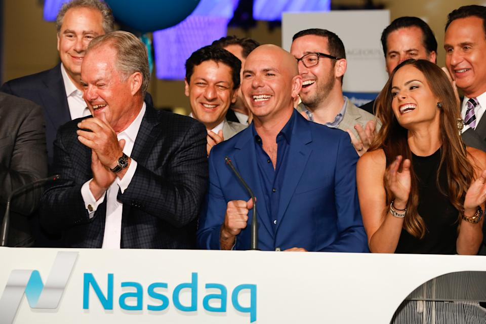Rapper Pitbull rings the Nasdaq closing bell, joined by L to R: Mark Hoffman (CNBC President), Manny Medina (eMerge founder), Nick Deogan (SVP and EIC, Business News, CNBC), Xavier Gonzalez (ED of eMerge), Melissa Medina (VP of Business Development, eMerge) and Jose Diaz-Balart (anchor, Noticiero Telemundo) at the eMerge Conference on May 4, 2015.