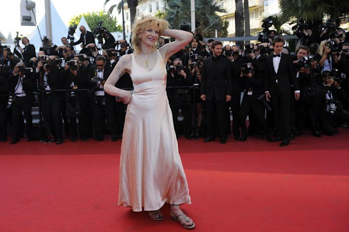 """US singer Courtney Love posing on the red carpet before the screening of """"This Must Be The Place"""" presented in competition at the 64th Cannes Film Festival on May 20, 2011 in Cannes"""