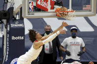 New Orleans Pelicans center Jaxson Hayes watches the ball on his attempted dunk during the first half of the team's NBA basketball game against the Denver Nuggets in New Orleans, Friday, March 26, 2021. The ball rolled out and there was no score. (AP Photo/Rusty Costanza)