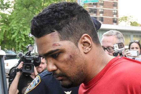 Richard Rojas is escorted after being processed in connection with the speeding vehicle that struck pedestrians on a sidewalk in Times Square in New York City