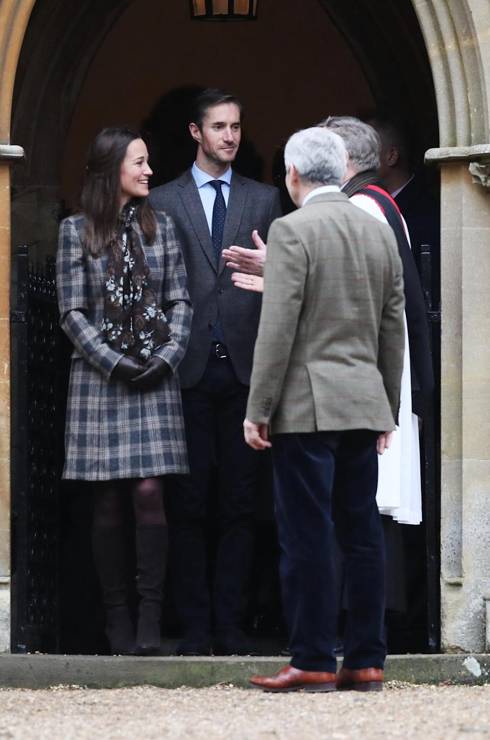 <p>Pippa went to church with the Duke and Duchess of Cambridge and her husband-to-be while dressed in a muted tweet coat and suede knee-high boots. <i>[Photo: Getty]</i> </p>