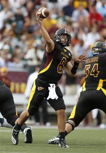 Central Michigan quarterback Ryan Radcliff (8) throws a pass as Nick Beamish (54) blocks during the second quarter of an NCAA college football game against Michigan State, Saturday, Sept. 8, 2012, in Mount Pleasant, Mich. (AP Photo/Al Goldis)